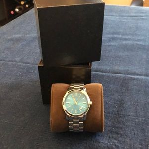 Silver Michael Kors watch with blue face